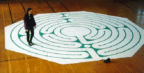 Large photoof Judy Hopen walking a canvas Santa Rosa labyrinth.
