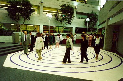 Photo of people walking the canvas 7-circuit labyrinth.