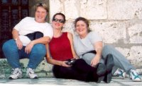 Photo of Diane, Judy, and Lea, leaning against a wall in Chartres, France.