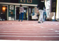 Photo of students walking a masking tape labyrinth.