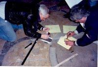 Photo of Robert Ferre and Rob Sovinski measuring the Chartres labyrinth.