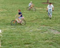 Photo of kids riding bicycles in a rope labyrinth.