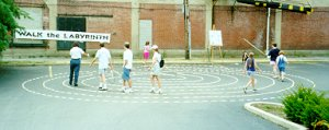 Photo of people walking the wood block labyrinth.