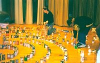 Photo of labyrinth being laid out with cans of food.
