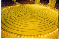 Photo of Chartres labyrinth surrounded by candles.